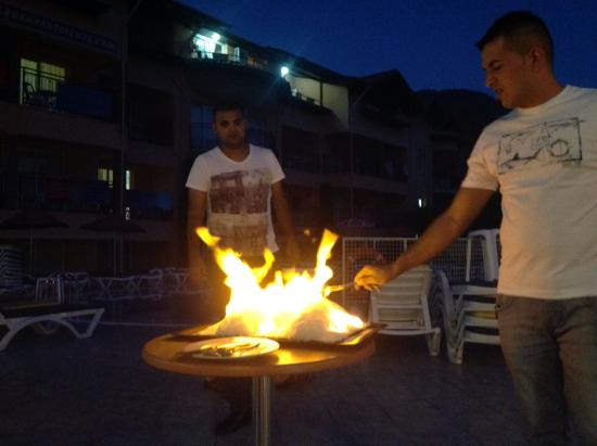 Club Sun Village: Staff preparing sea bass cooked in salt.  It was delicious and can recommend it.