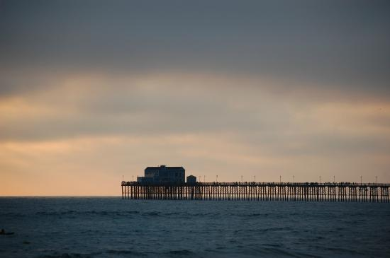 A Strand of Paradise: Standing on the beach in front of units, looking at the pier