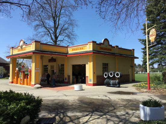 An authentic Shell Service Station with car wash and vintage pumps