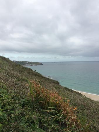 Trevedra Farm Caravan and Camping Site: view from the top of Gwenver beach towards Sennen