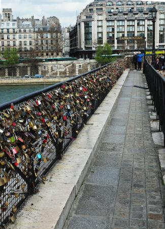 Beautiful Parisienne bridge being damaged by misguided tourists