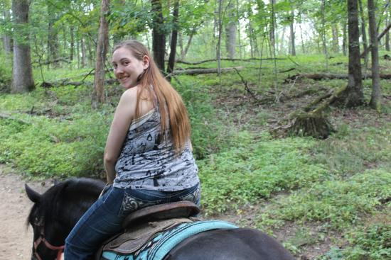 Canyon Creek Horseback Riding Stables : Happily riding Renegade the horse.
