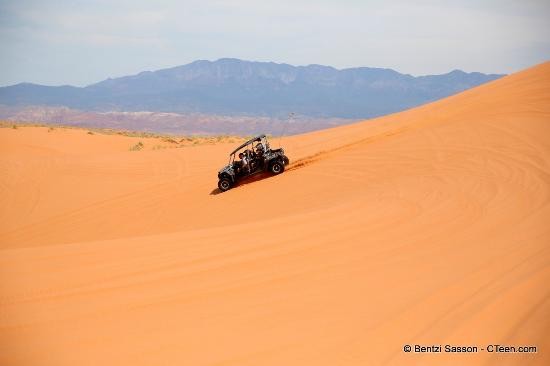 Southern Utah Adventure Center : Having some fun in dunes