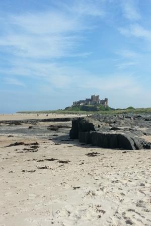Longhoughton, UK: Bamburgh beach and castle in August 2015