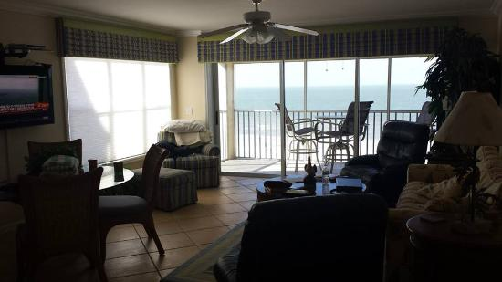 Bay To Beach Resort: View of the living room and balcony.