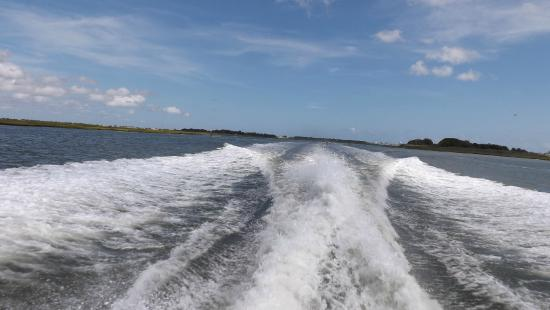 Silver Bullet Tours: The wake left behind as the Silver Bullet speeds across the waves.