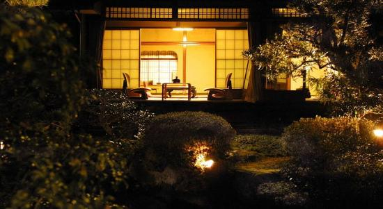 The room of Hotel Kyoto Garden seen from the garden in the night