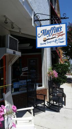 Photo of Muffin's Ice Cream Shop sign from downtown Mebane sidewalk in front of store
