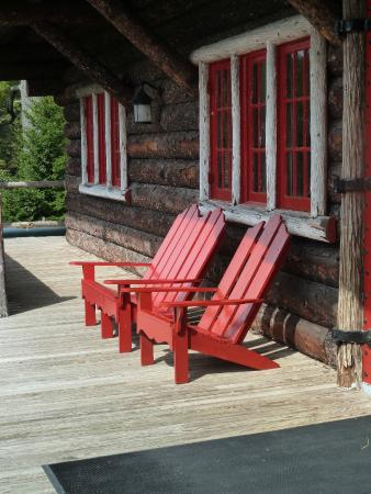 Great Camp Sagamore: Porch Detail, Main Lodge With Signature Red Adirondack  Chairs