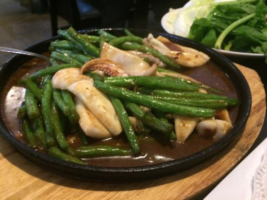 Beef steak with black pepper sauce, squid with green beans, chilli and ...