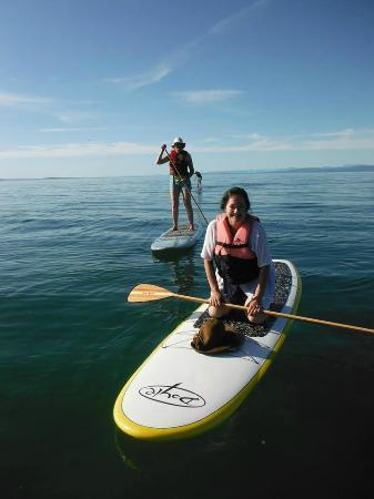 At Nautica Tigh Bed & Breakfast: Your Hostess, enjoying Paddleboard lessons at our beach!