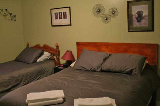 Big Land Bed and Breakfast: Rm no.1 has a queen bed&a twin  bed ,a closet , dresser,chair , fan ,clockradio, wi fi