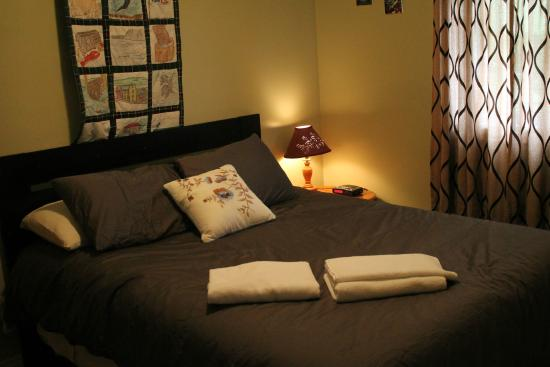 Big Land Bed and Breakfast : Room no. two has a queen bed ,closet , dresser , chair, clock radio. endtable , lamp, tv, fan &