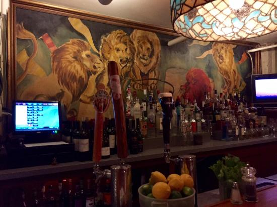 Lion's Den Pub: Behind the bar (note, the 'red lion') ;-)