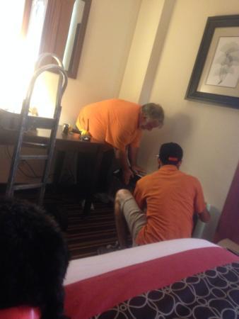 La Quinta Inn & Suites Salisbury: 2 maintenance men putting in a 2nd broken A/C unit