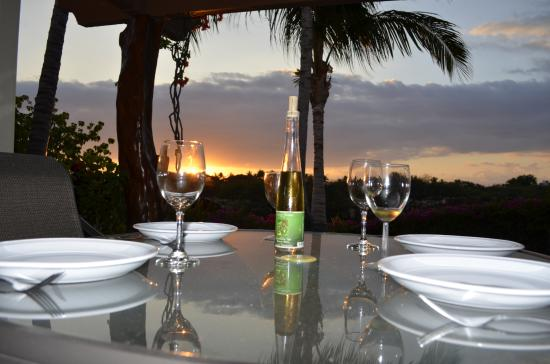 Palm Villas at Mauna Lani : Sunset from our dinner table on the lanai of our unit.