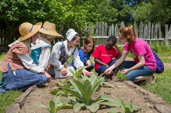 Maryland: Children and interpreter at Godiah Spray Tobacco Plantation in Historic St. Marys City.