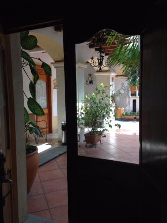 Los Pilares Hotel: Looking out windowed door of our room to left--2nd fl patio