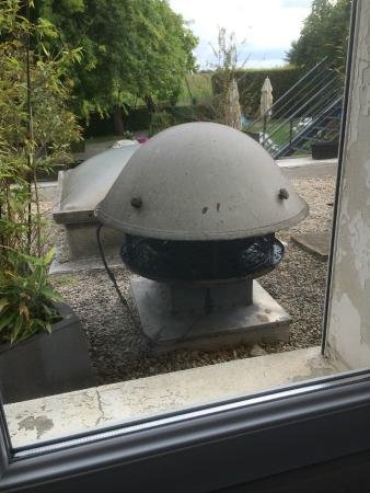 Fontenai-sur-Orne, France : Noisy extractor outside window