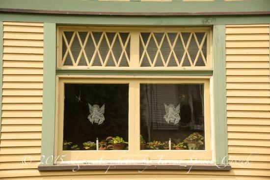The Queen - A Victorian Bed and Breakfast: dining room windows