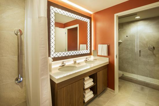 The 100 square foot bathrooms feature dual sinks, tub and shower ...