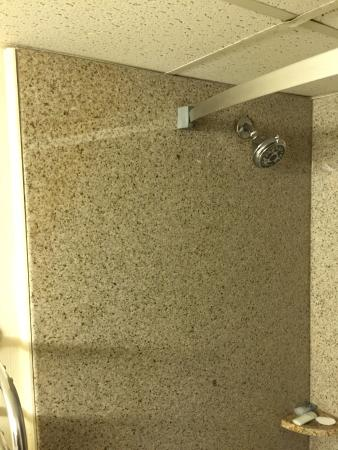 Curved Shower Curtain Rod not mounted properly. It\'s too far inward ...