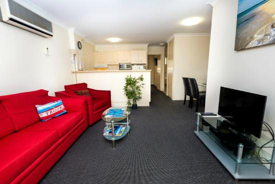 Beaches Serviced Apartments: Large LED TV, dining area,
