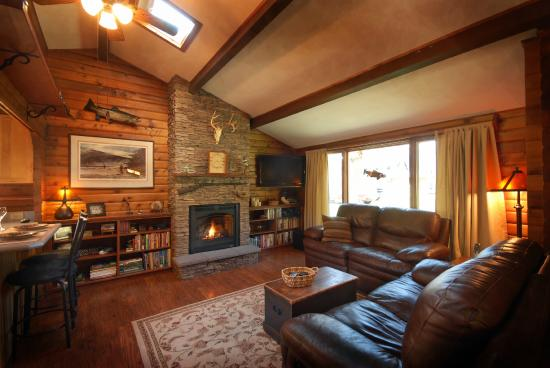 Clinton, MT: Sawmill Living Room with Fireplace