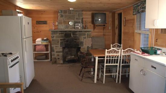 The Forks, ME: Dining/Living Room Area with Fireplace