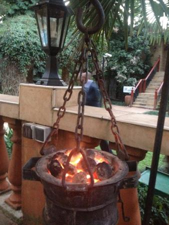 Town Lodge Upper Hill Nairobi: Coal fire to keep me warm by the pool