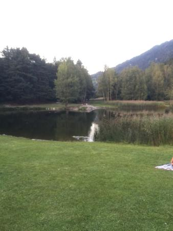 Hotel Tramserhof : View of the swimming pond and dinner on the terrace.