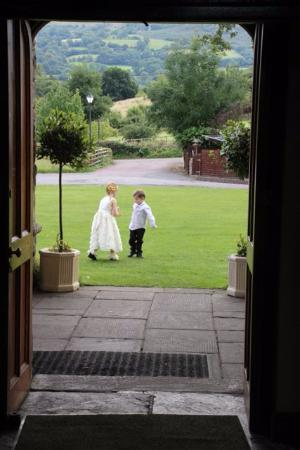 The Old Rectory Country Hotel and Golf Club: Flower girl and pageboy on the front lawn