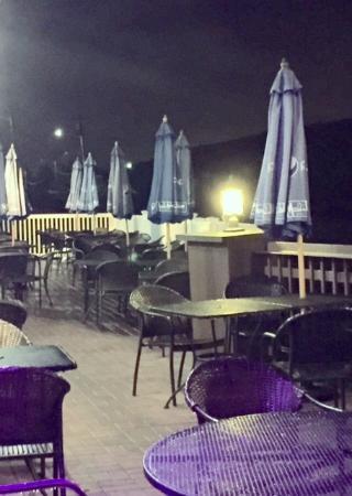 Superior Peteru0027s Clam Bar U0026 Seafood Restaurant: Peteu0027s Patio On A Misty, Wet Night