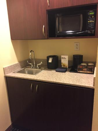 SpringHill Suites Orlando Airport: Kitchen area: microwave, sink, fridge, coffee maker