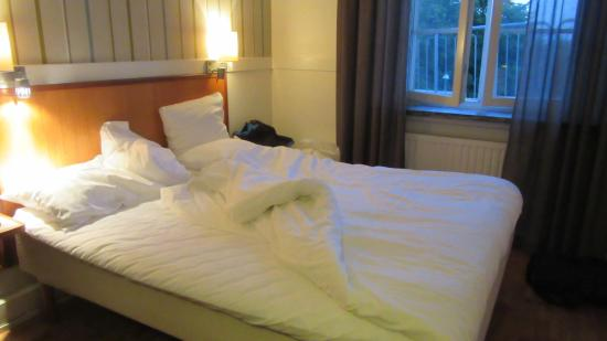 Clarion Collection Hotel Post: Bed in small bedroom