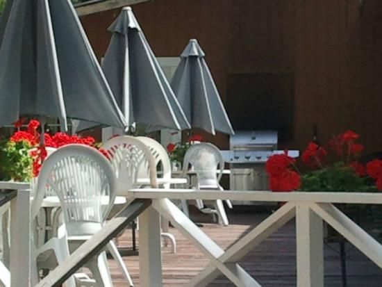 The Hideaway Motel: Deck, tables, and umbrellas