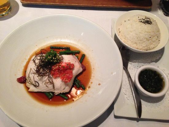 """Roy's Waikiki Beach: """"Chinese Style"""" Monchong, sizzling soy and Asian aromatic Relish over string beans..."""