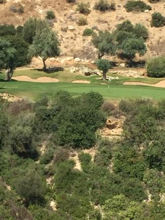 Aphrodite Hills Golf Course: The signature 7th. Close your eyes and hit it clean!