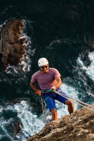 Aqua Wellness Resort: Climb the cliff at the tip of Aqua's bay, then rappel down!