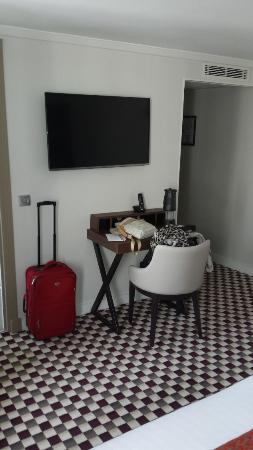 cute sitting area and tv picture of phileas hotel paris. Black Bedroom Furniture Sets. Home Design Ideas