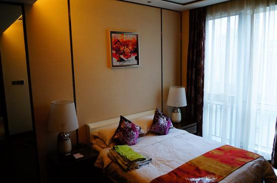 Yiside Poly Zhonghui Plaza Hotel: View of Bedroom