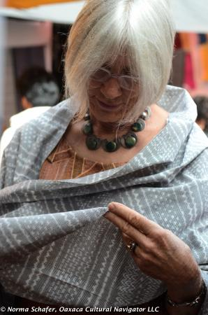 Examining the finely woven cloth