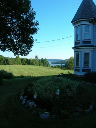 The Inn on Lake Champlain : View of tower,field and lake in morning