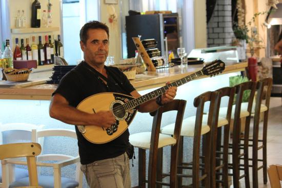 Despina Taverna : Entertainment.........he goes around all the restaurants!