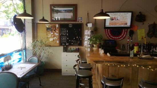 Freckles' Gourmet BBQ: Front of the place, with items for sale, and part of the counter.
