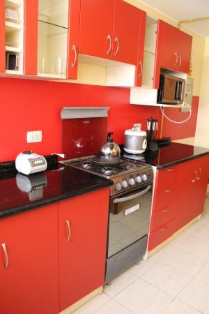 Inkari Apart Hotel: Cocina / Interior de habitación