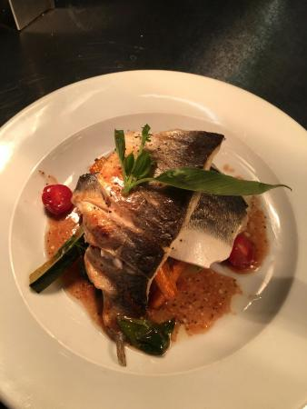 Milton, UK: Grilled Sea Bass, Potato Rosti, Sautéed Vegetables and Sauce Veirge