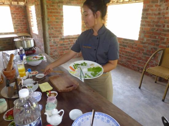 Mo's Village Cooking Adventure: Mo demonstrating the ingredients for the spring roll