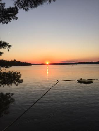 Vassalboro, ME: Sunset from dock and swim area of webber pond at green valley campground