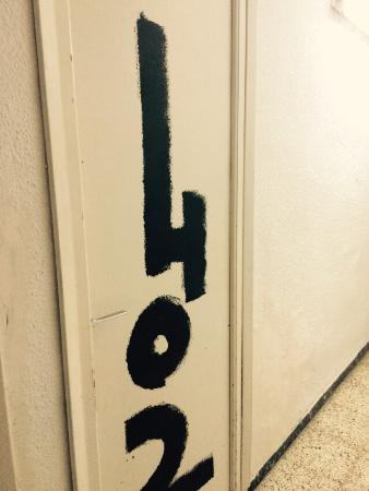 Esmeralda Beach Hotel: Our room number indicator .. a brush dipped in black paint.. ART????